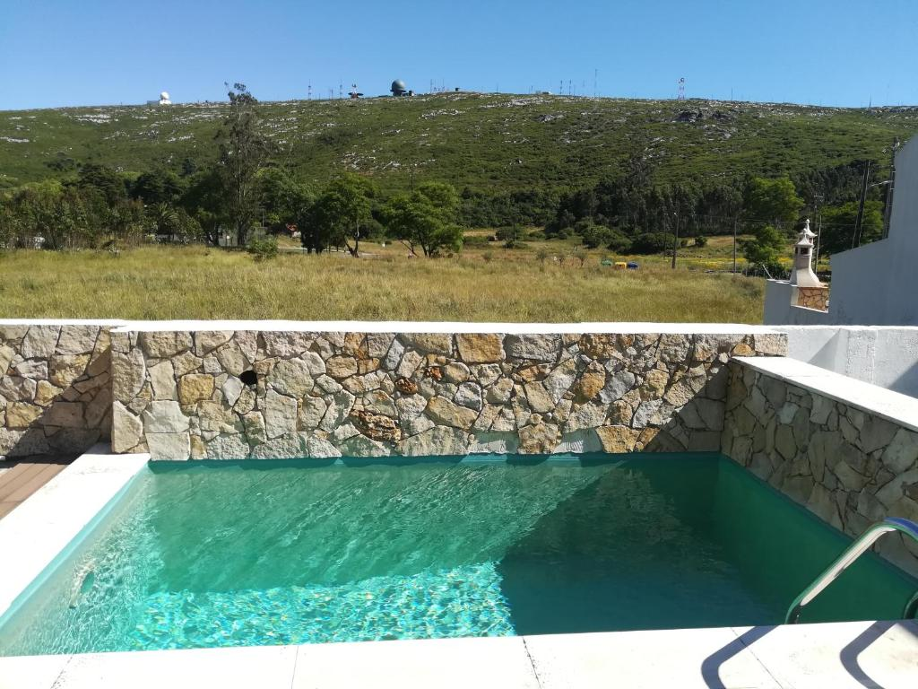 A view of the pool at Pro Touristic Montejunto Villas or nearby