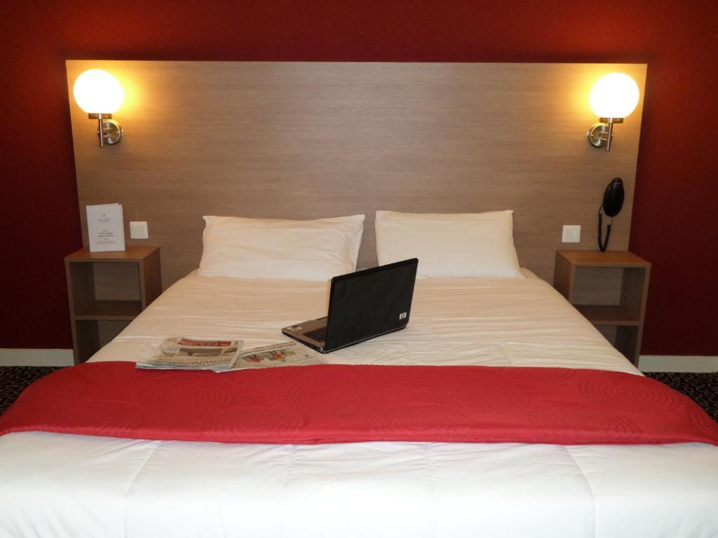 Un ou plusieurs lits dans un hébergement de l'établissement Hotel La Luna