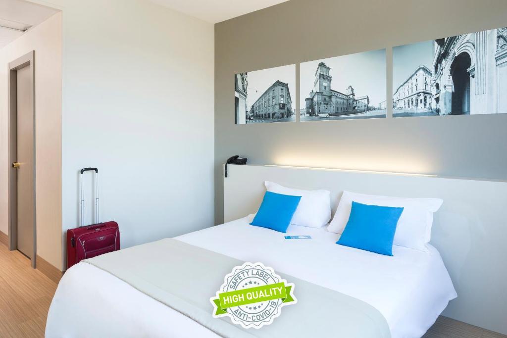 Letto o letti in una camera di B&B Hotel Ferrara