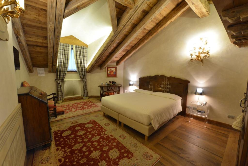 Letto o letti in una camera di Le Reve Charmant