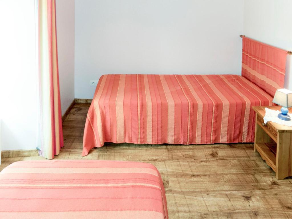 Un ou plusieurs lits dans un hébergement de l'établissement Holiday Home Le Chant de Tüts - BYL100