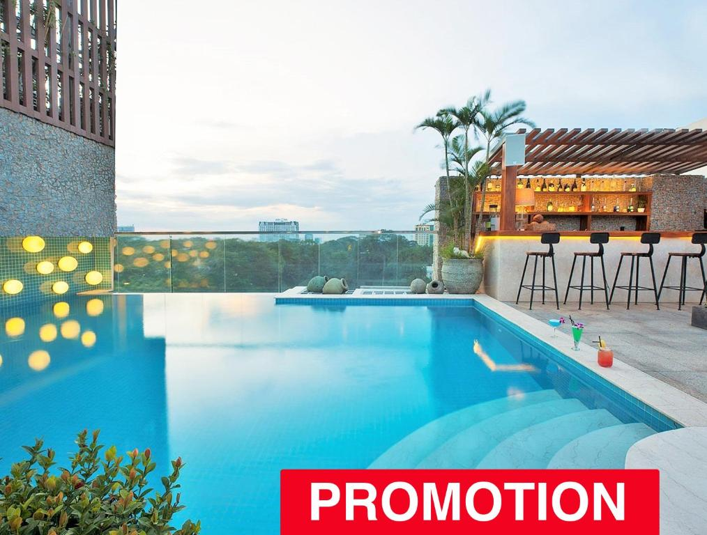 The swimming pool at or near A&EM Signature Hotel - Quarantine Hotel