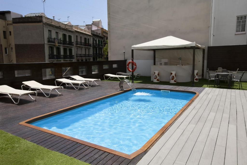 The swimming pool at or near Hotel Concordia Barcelona