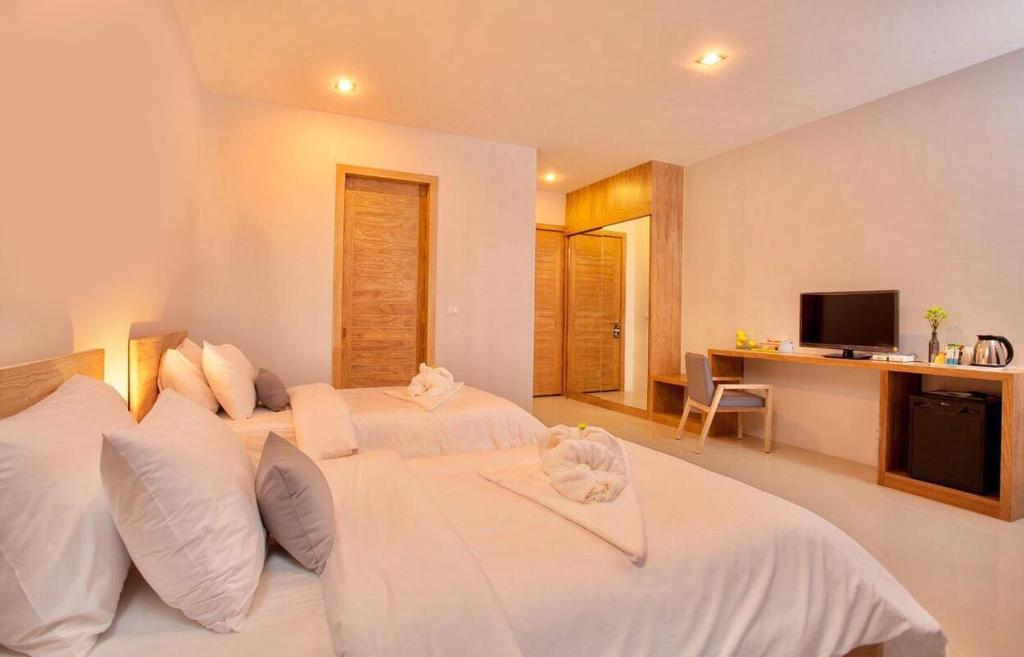 A bed or beds in a room at Lemonade Phuket Hotel -SHA Plus