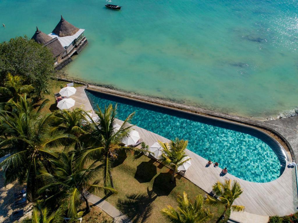 Vue sur la piscine de l'établissement Veranda Paul et Virginie Hotel & Spa - Adults Only ou sur une piscine à proximité