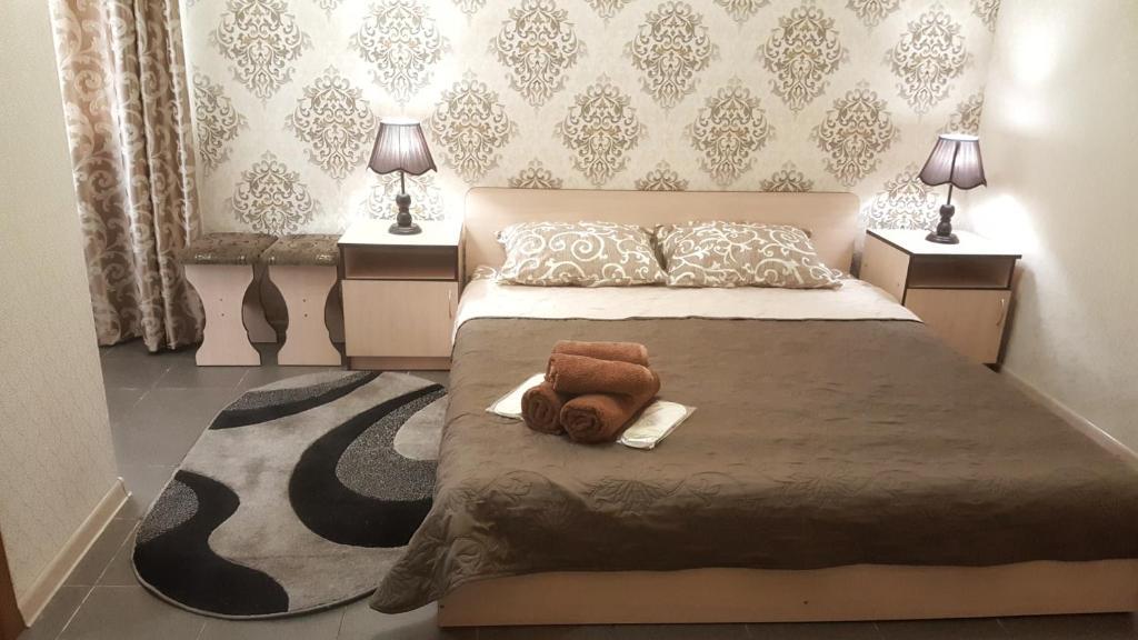 Кровать или кровати в номере ФЕЯ-центр города