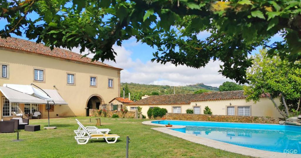 The swimming pool at or near Hospedaria do Convento d'Aguiar- Turismo de Habitacao