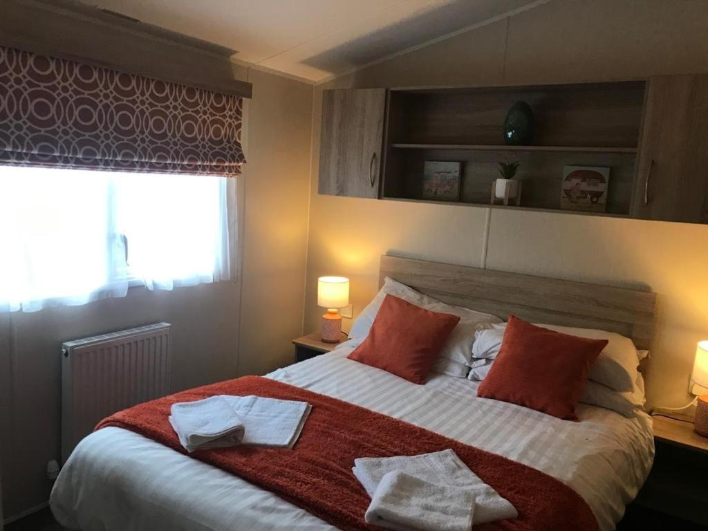 A bed or beds in a room at 156 Newquay Bay Resort