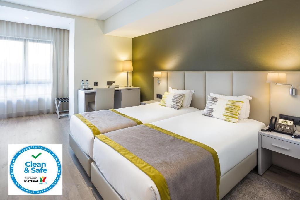 Letto o letti in una camera di Empire Lisbon Hotel