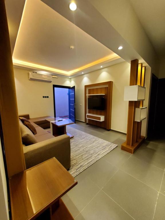 Uma área de estar em باشن للفلل الفندقية