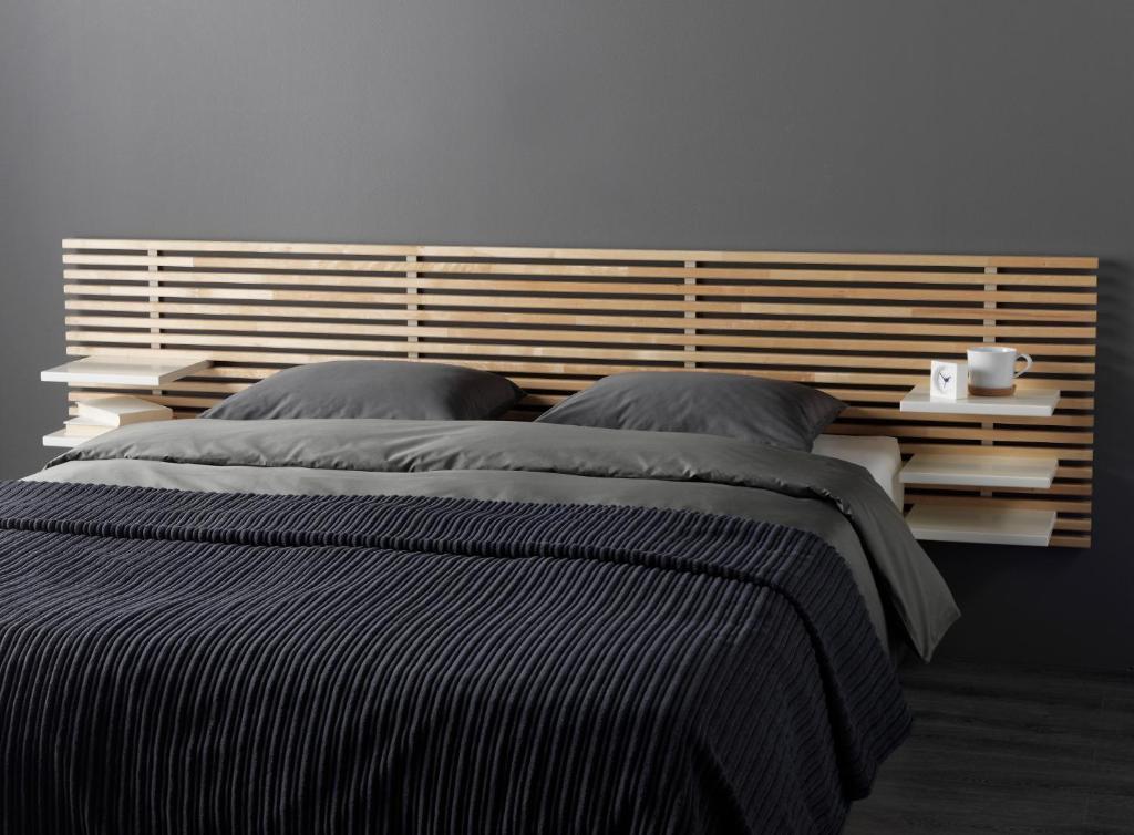 Кровать или кровати в номере Hotel Les Arcades