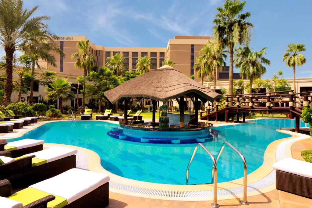 The swimming pool at or near Le Méridien Dubai Hotel & Conference Centre