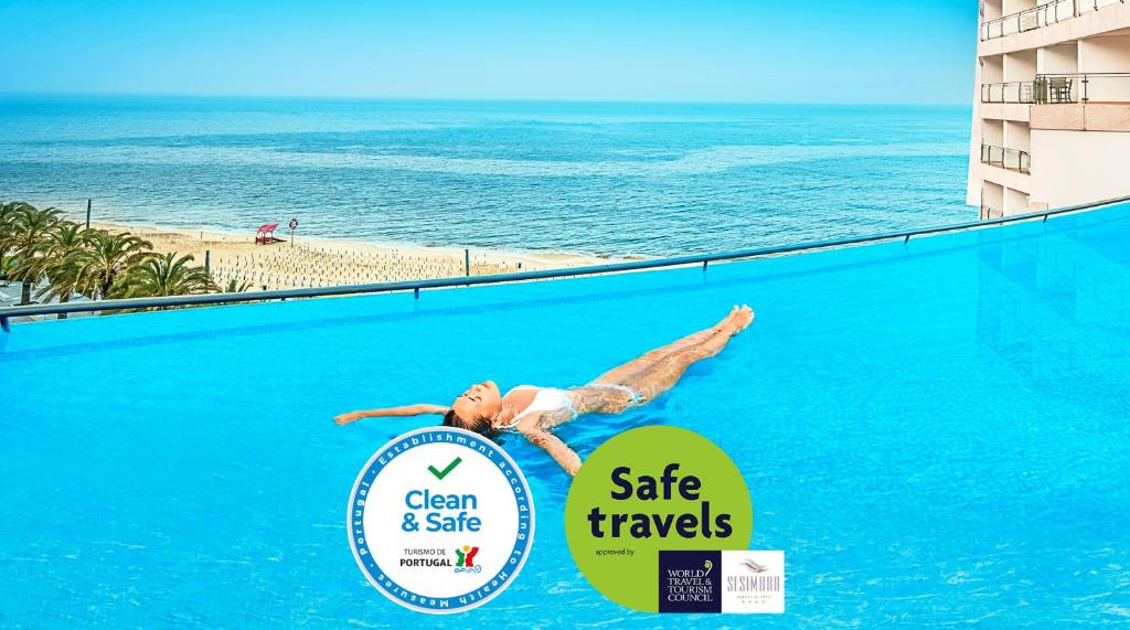 A view of the pool at Sesimbra Hotel & Spa or nearby