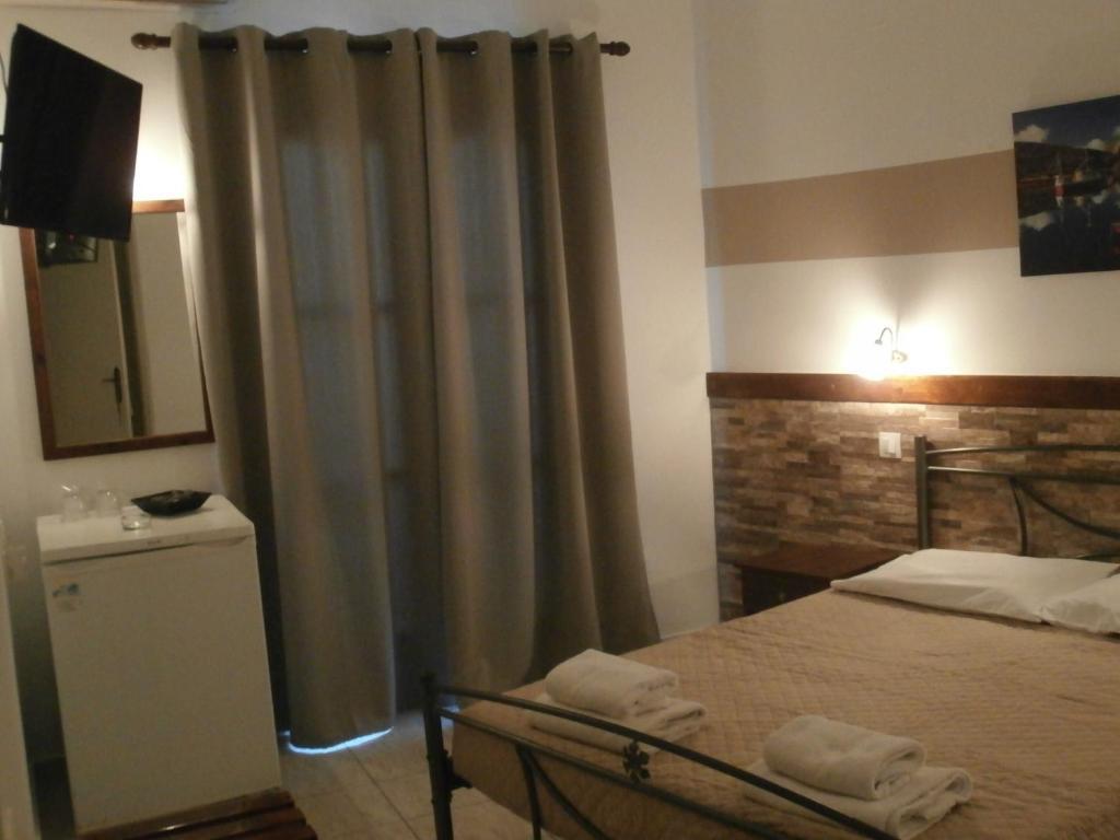 Ein Bett oder Betten in einem Zimmer der Unterkunft Narkissos Hotel