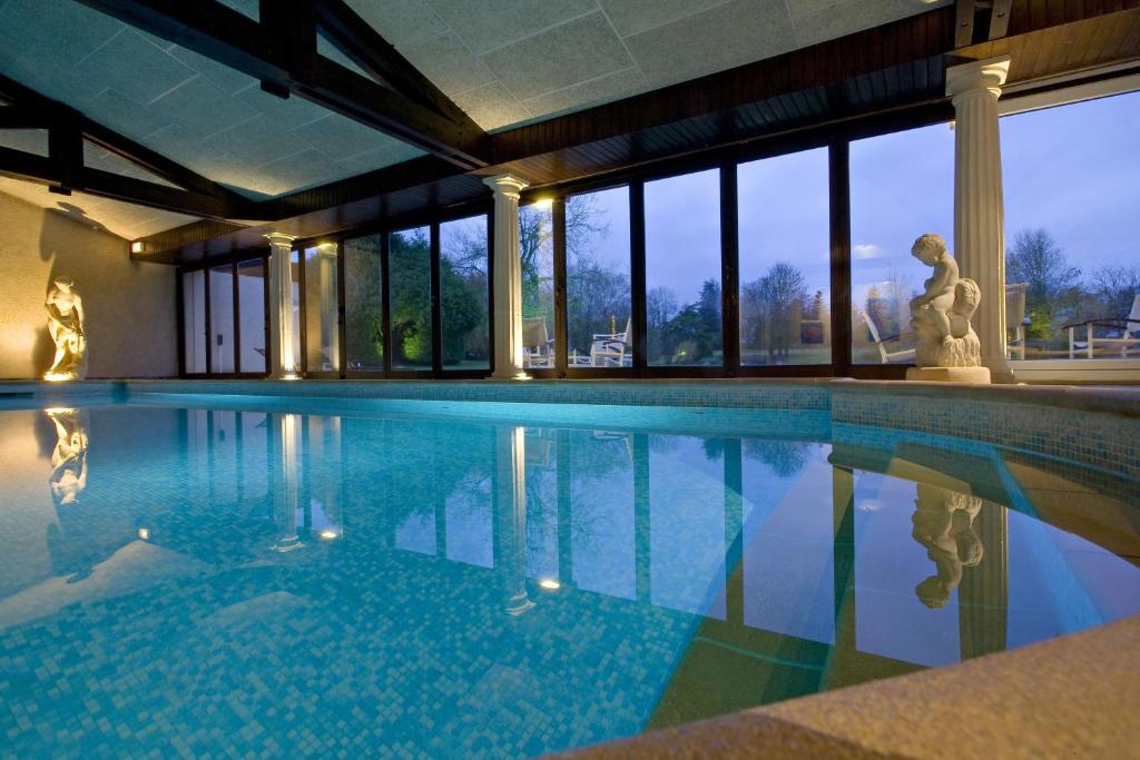 The swimming pool at or near Relais du Bois Saint Georges - Hôtel de Charme