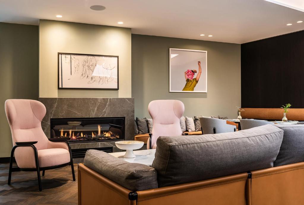 A seating area at Maximilian Hotel