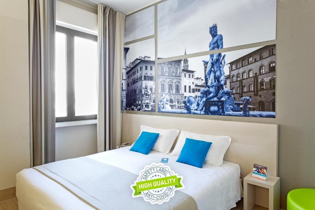 A bed or beds in a room at B&B Hotel Firenze Nuovo Palazzo Di Giustizia