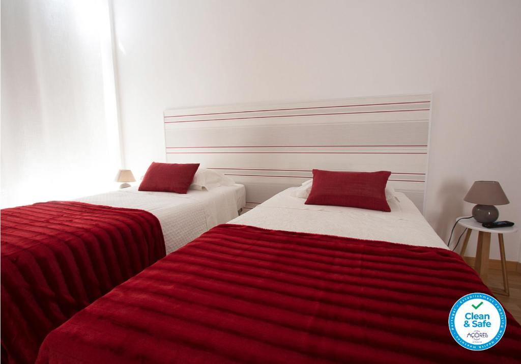 A bed or beds in a room at Central Guesthouse