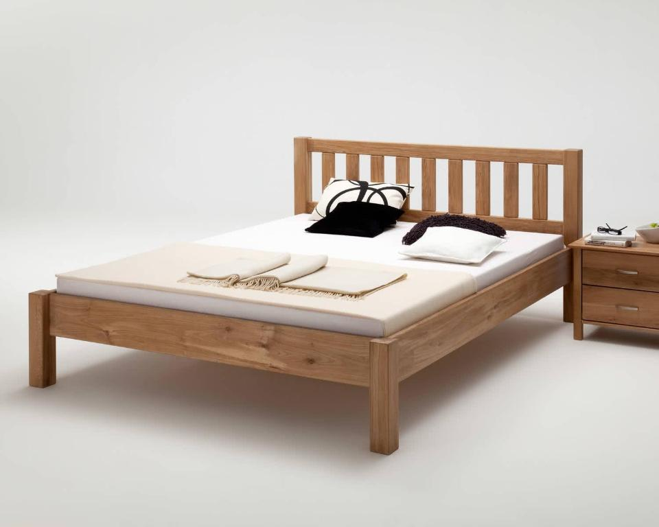A bed or beds in a room at Gästehaus Kuchen