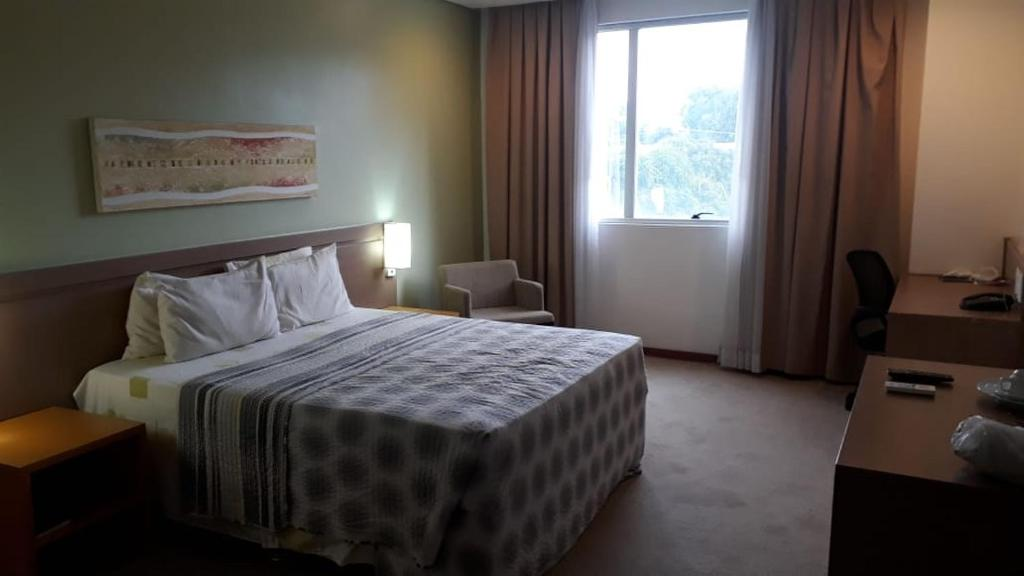 A bed or beds in a room at Apto particular em Hotel 4 estrelas