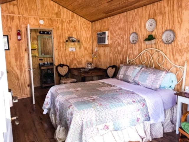 A bed or beds in a room at Cowboys and Angels Retreat