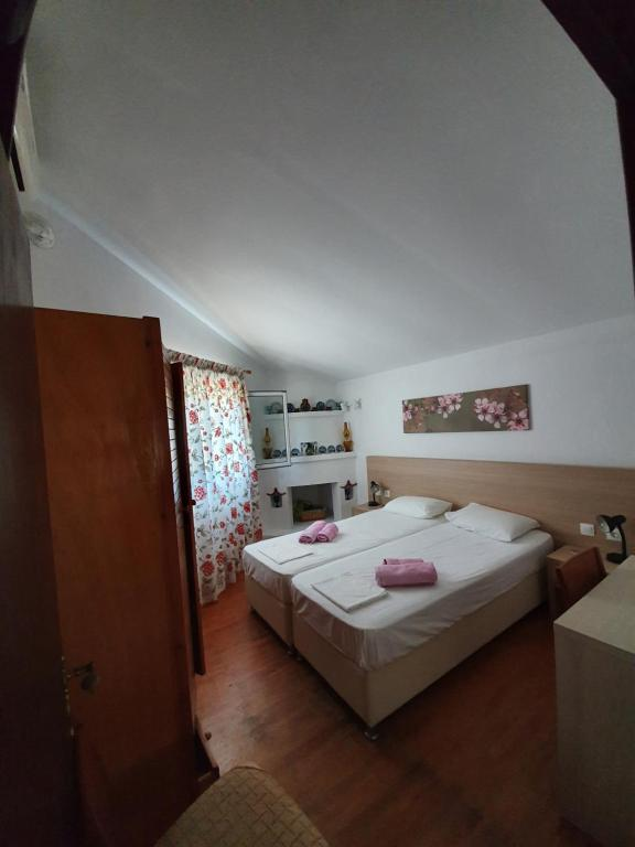 A bed or beds in a room at Dionisos Studios and Apts Skiathos