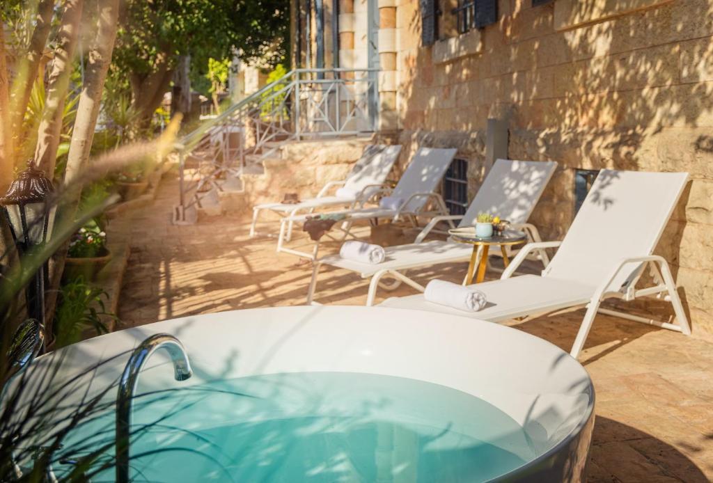 The swimming pool at or near Villa Ba'Moshava - a member of Brown Hotels