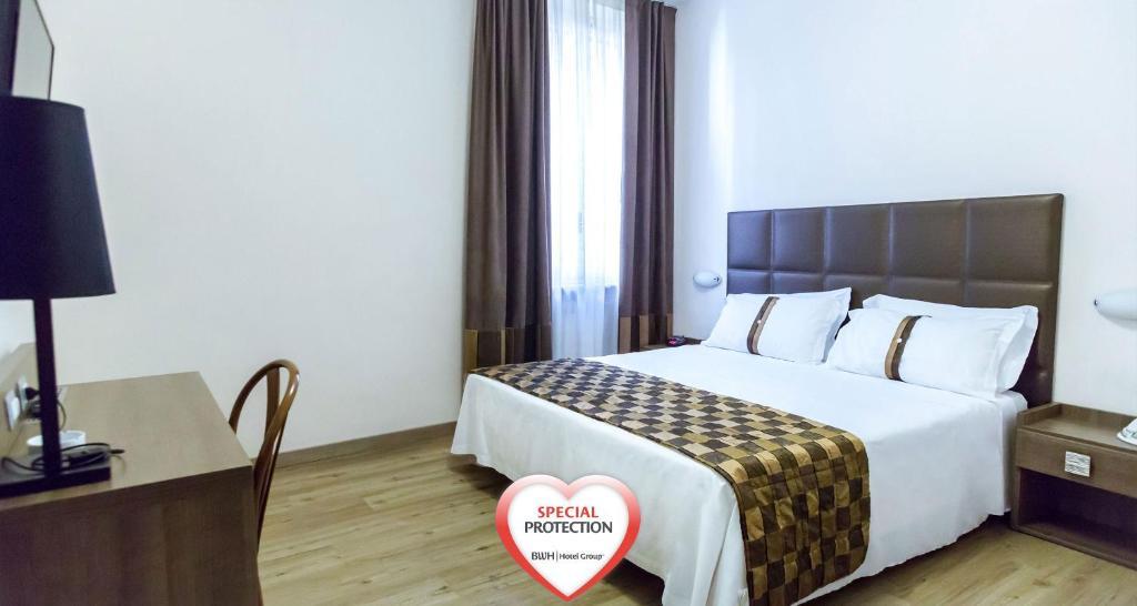 Кровать или кровати в номере Best Western Hotel Libertà