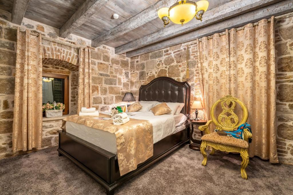 A bed or beds in a room at Heritage Palace Varos - MAG Quaint & Elegant Boutique Hotels