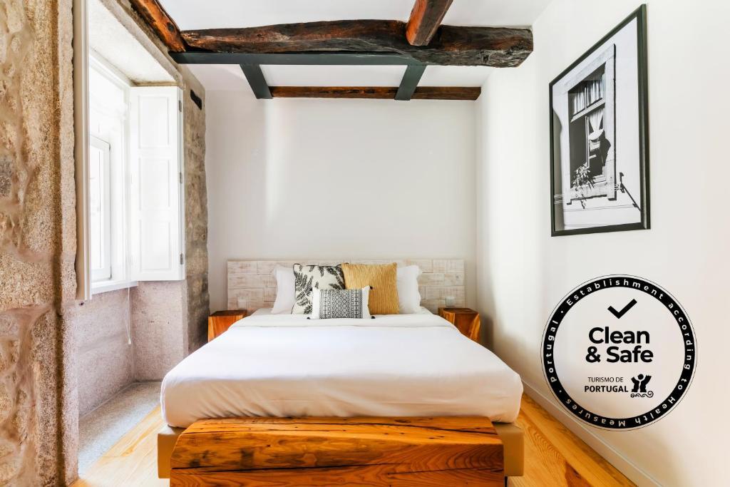 Een bed of bedden in een kamer bij Stay In Apartments
