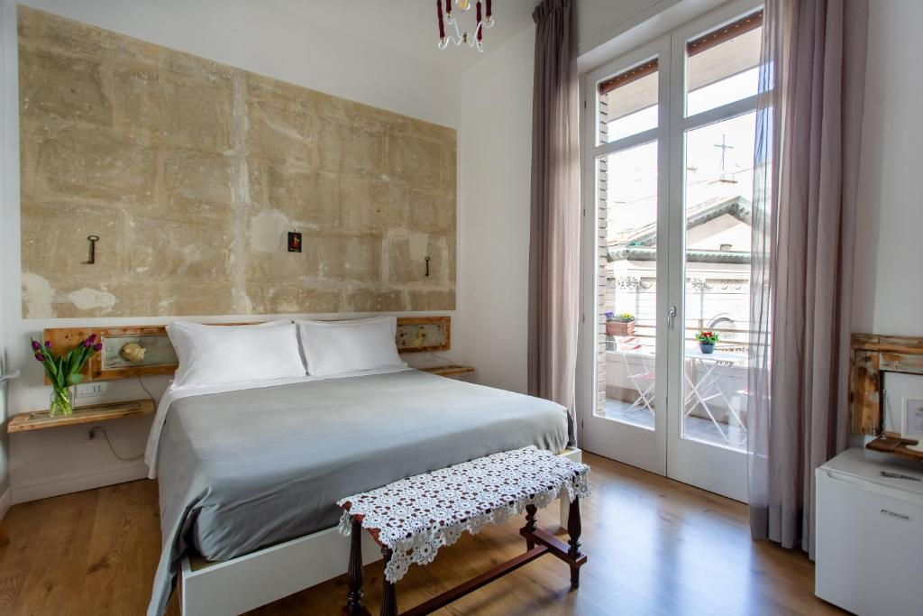 Letto o letti in una camera di Napoli Bonita b&b