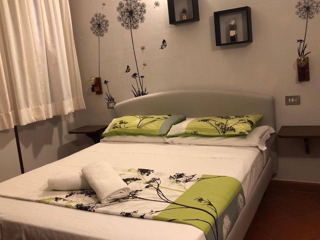 Ein Bett oder Betten in einem Zimmer der Unterkunft Notti Etrusche a Sovana