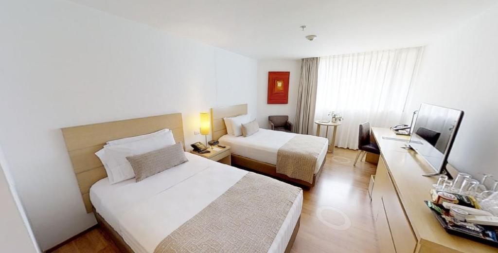 Кровать или кровати в номере Hotel Estelar Blue