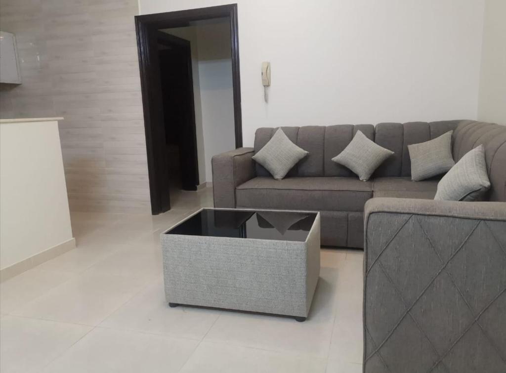 Uma área de estar em Sharm Beach Suites