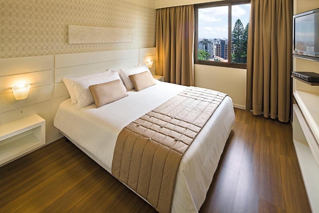 Cama ou camas em um quarto em Swan Porto Alegre