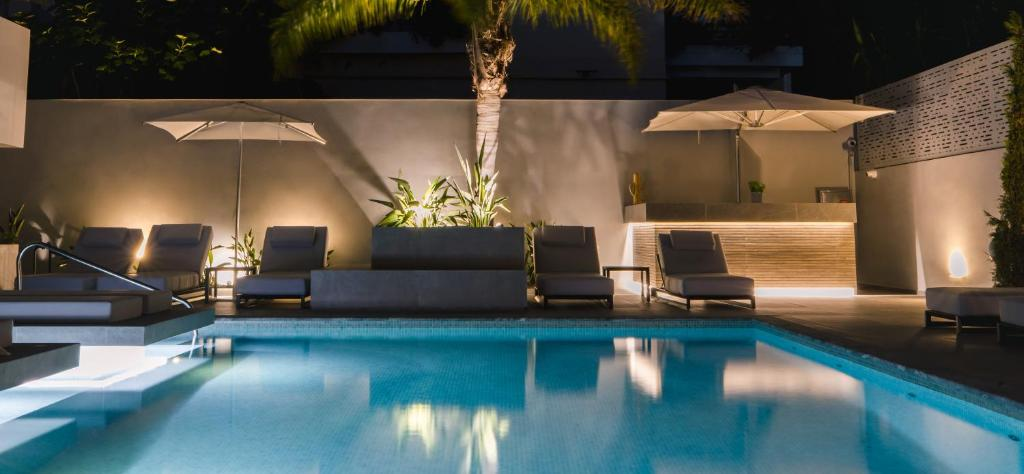 The swimming pool at or near Brasil Suites Boutique Hotel