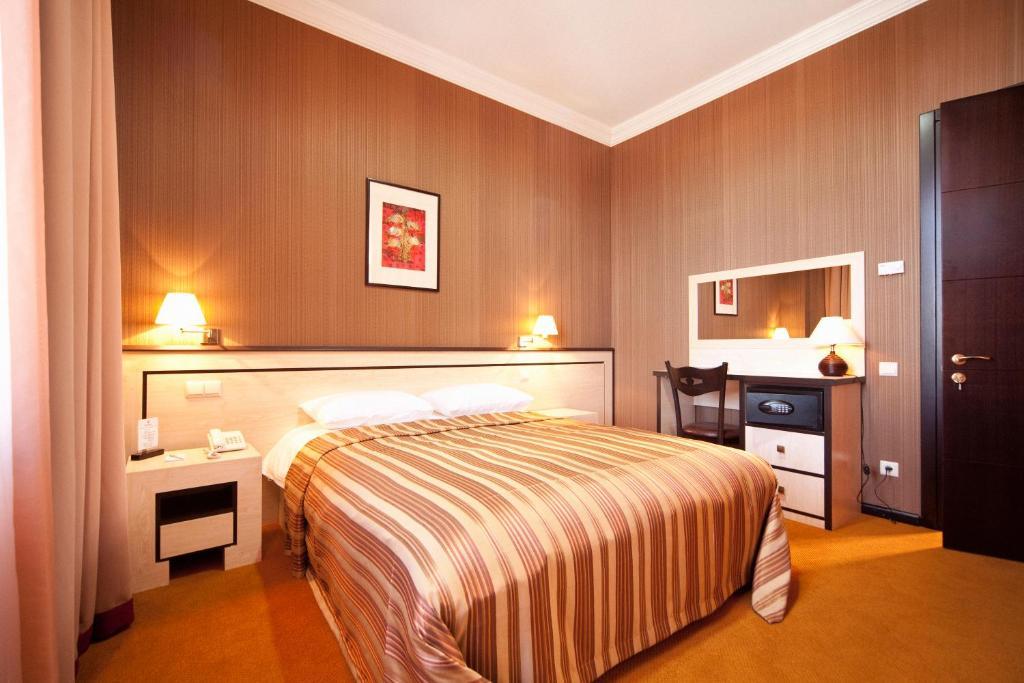 Кровать или кровати в номере Kopala Rikhe Hotel