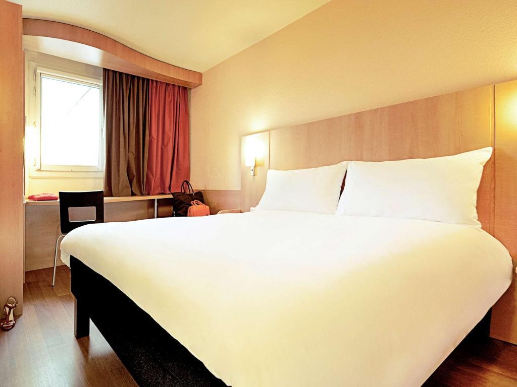 Cama ou camas em um quarto em ibis Sao Paulo Paulista