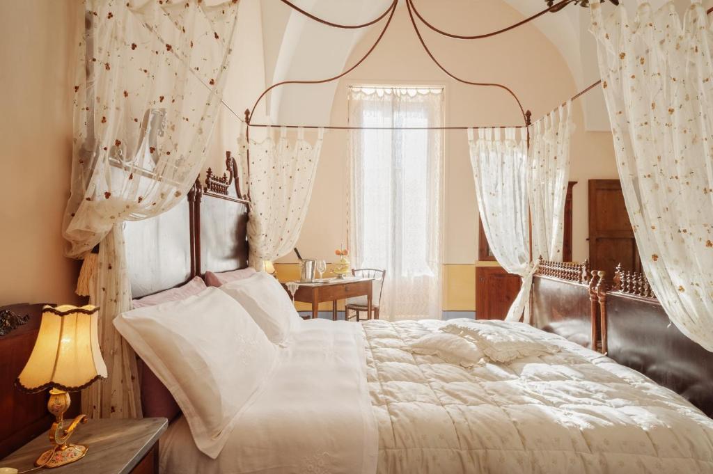 Letto o letti in una camera di Borgoterra