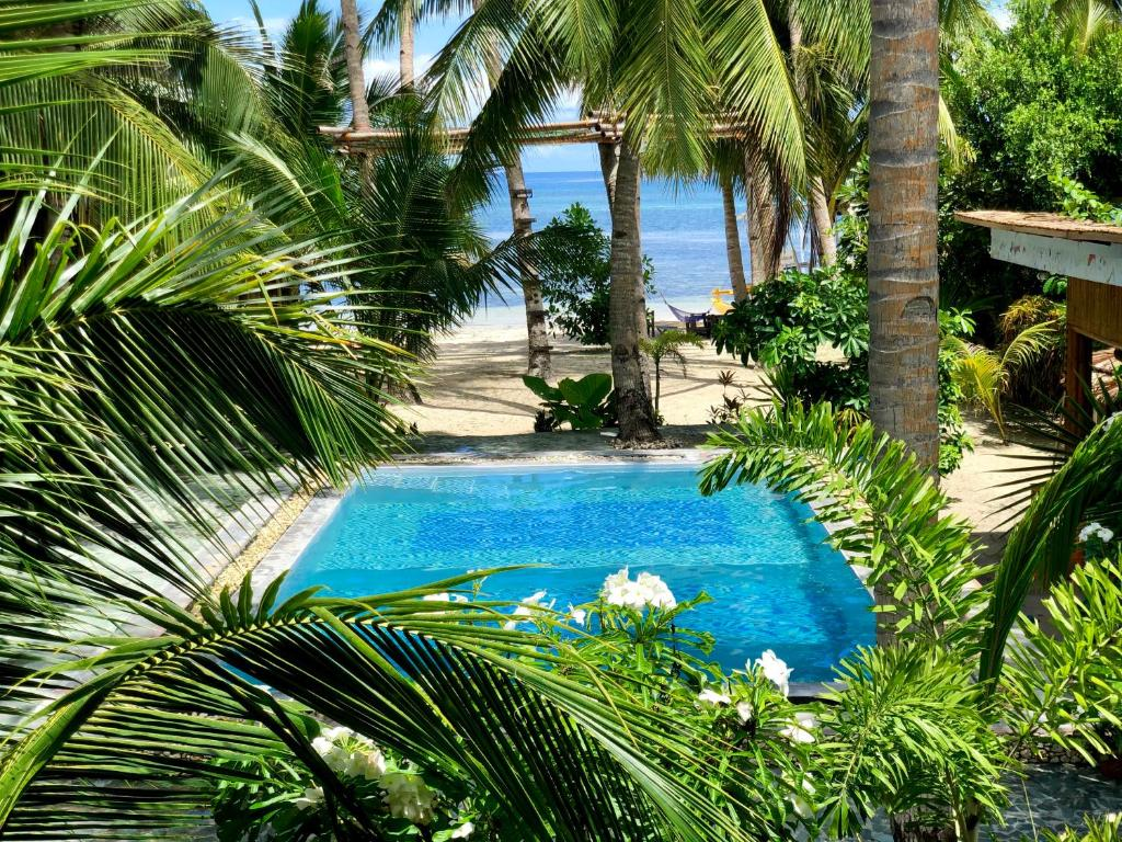 A view of the pool at Apo Diver Beach Resort or nearby