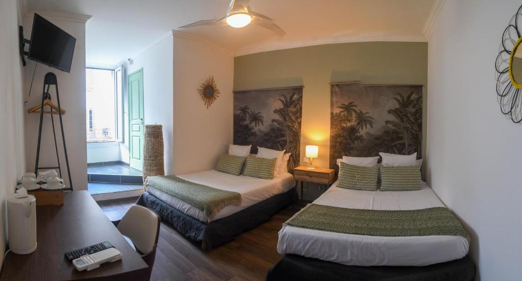 Un ou plusieurs lits dans un hébergement de l'établissement Hôtel du Palais Bastia Centre