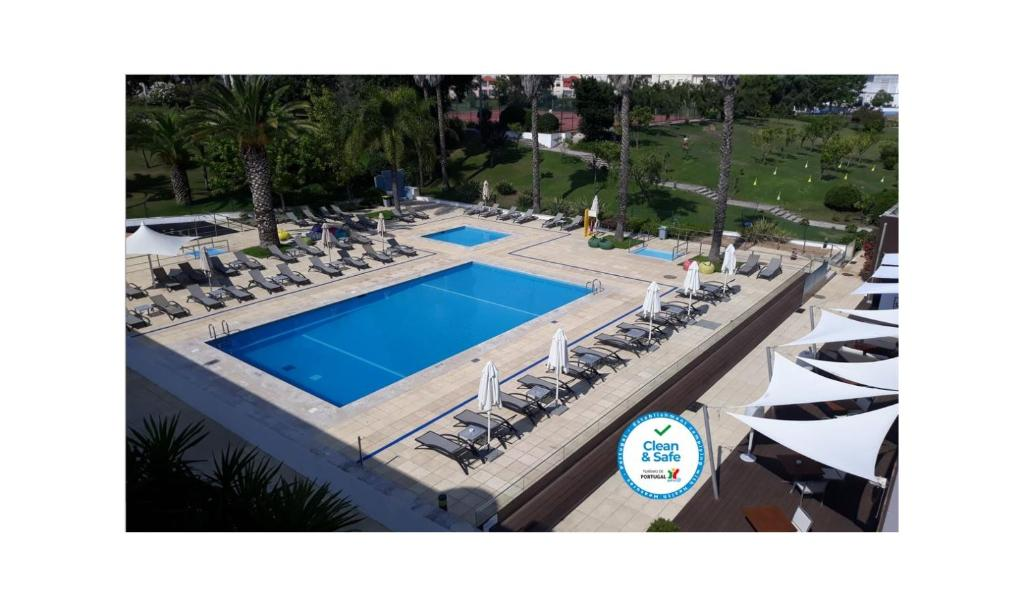 A view of the pool at Novotel Setubal or nearby