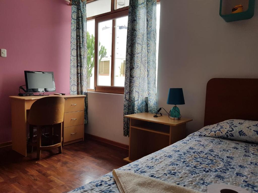 A bed or beds in a room at EL ENSUEÑO