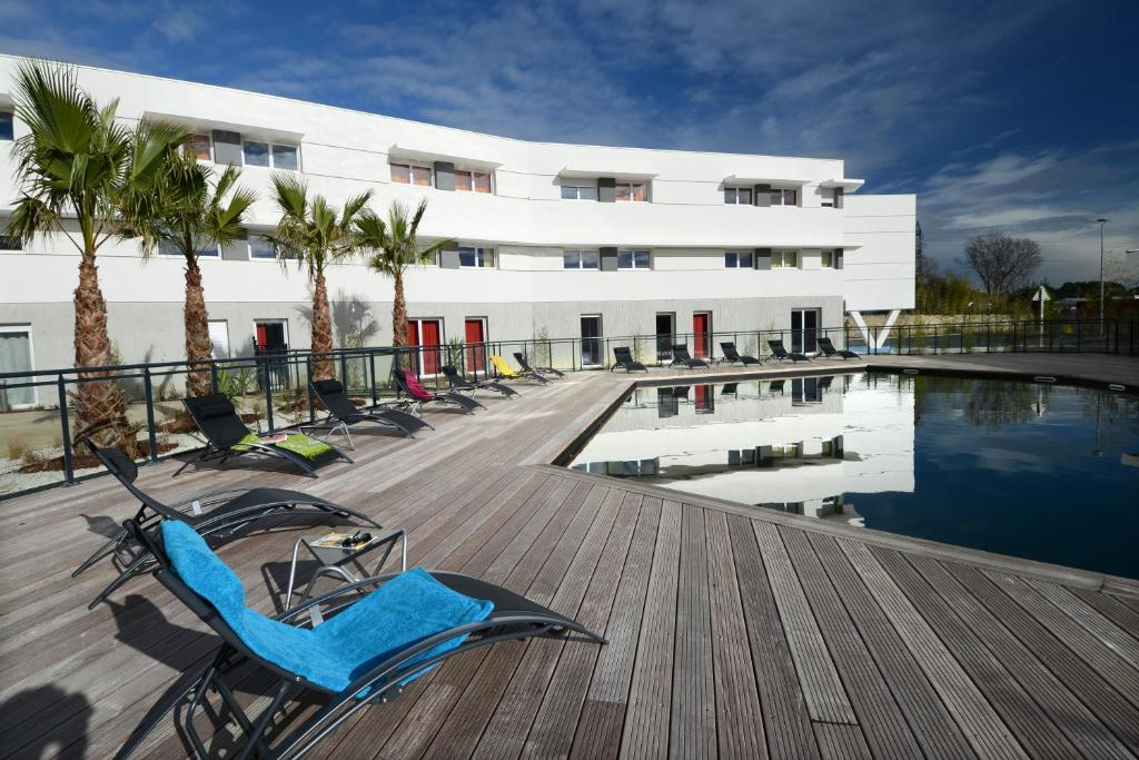 The swimming pool at or close to Vacancéole - Le Terral - Montpellier Sud