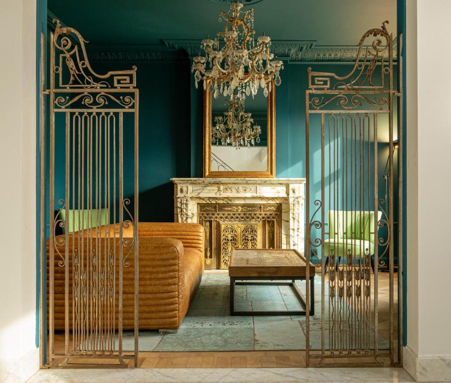 Een zitgedeelte bij Relais M - Chambre d'hôtes
