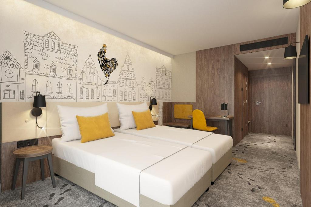 A bed or beds in a room at ibis Styles Lublin Stare Miasto