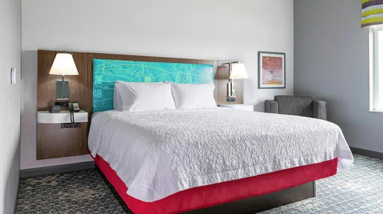 A bed or beds in a room at Hampton Inn & Suites Watsonville