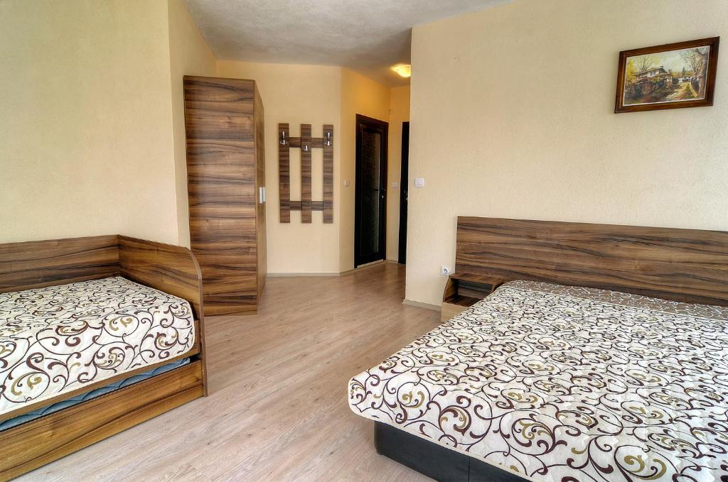 A bed or beds in a room at Advel Guest House