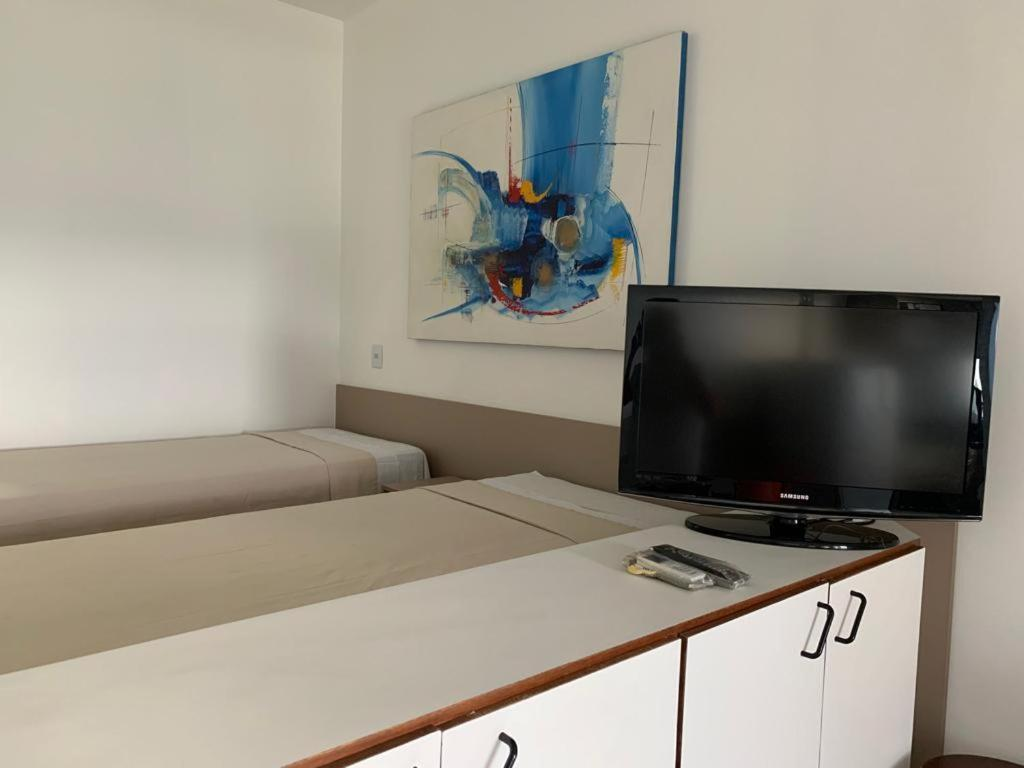 A television and/or entertainment centre at Bahia Flat - Barra