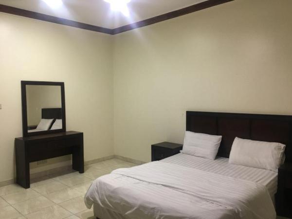 Cama ou camas em um quarto em هتون ينبع